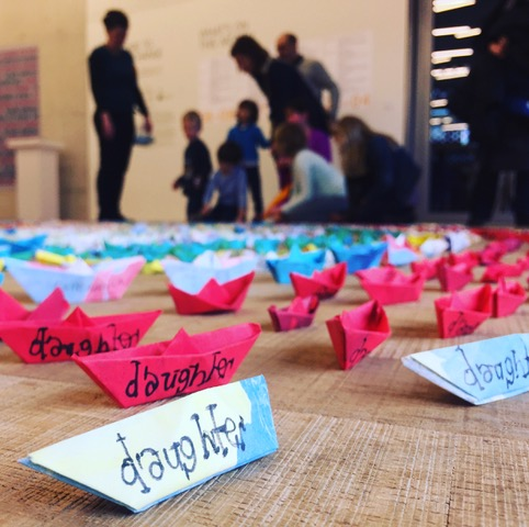Discussion with young children and their parents about the meaning of the boats in Who are We? Tate Exchange 2017. Photograph courtesy of Richard M Williams